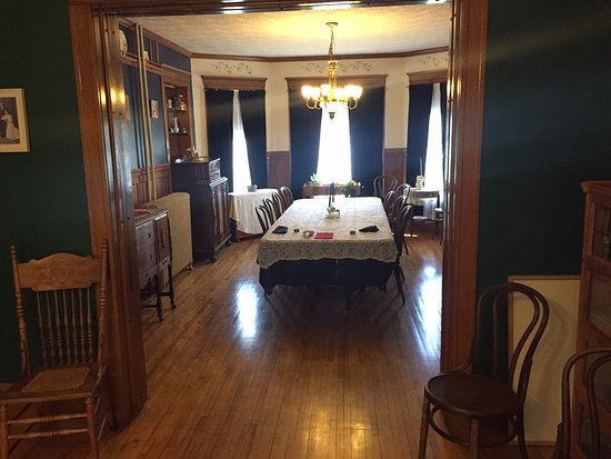 The Sawyer House Bed and Breakfast, Llc: One of the sitting rooms and view of the dining room