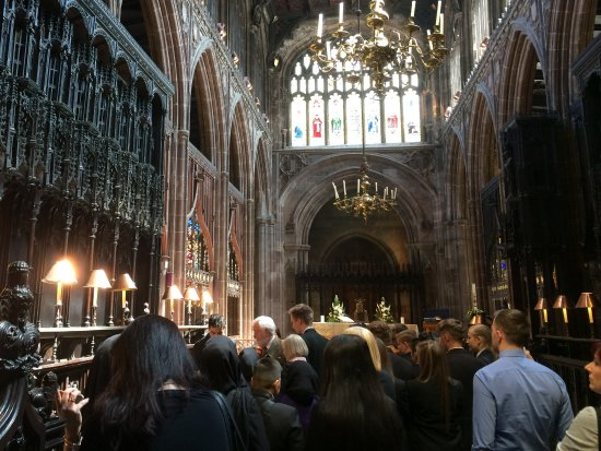 Manchester Cathedral: Party of school children in choir section.