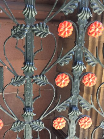 Manchester Cathedral: Wrought iron gate with red roses ( symbol of Lancaster.)