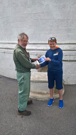 Start Point Lighthouse: My son James being presented with a picture of Start Bay Lighthouse