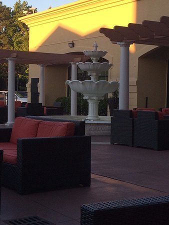 Courtyard With Fountain And Comfy Seating Picture Of Hilton Garden Inn Atlanta Airport