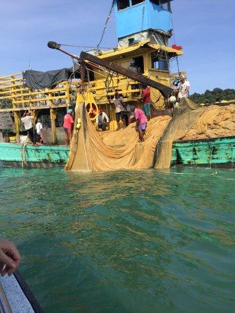 Pangkor Sandy Beach Resort: Fishermen hauling in the catch of the day.