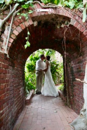 Key West Garden Club Bride And Groom Silhouetted In The Fort Archway
