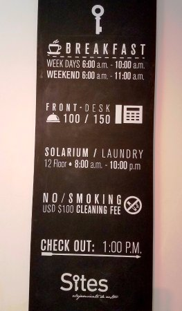 Hotel Sites 45: Info sign in hotel suite (Notice 1 pm checkout!)