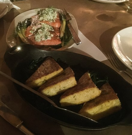 Eureka, MO: Poached salmon and polenta for four served family style.