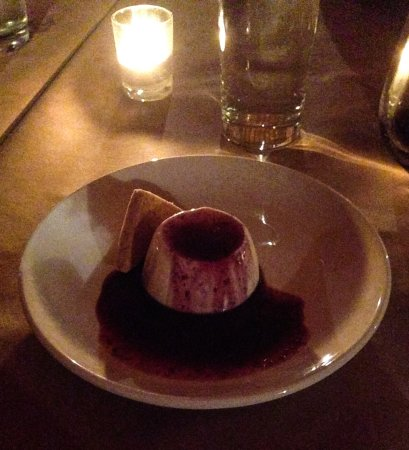 Eureka, MO: A fabulous Panna cotta with orange blackberry sauce.