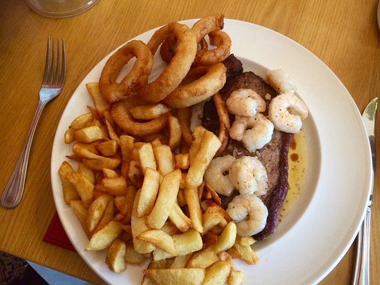 Cramlington, UK: Sirloin Steak garlic king prawns, onion rings and a peppercorn sauce on the side