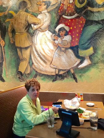Chesapeake, VA: Rose is seated below part of a very handsome room long mural.