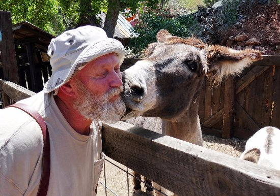 Jerome, AZ: Long time Gold King resident Pedro (on the right) gives Mick a kiss.