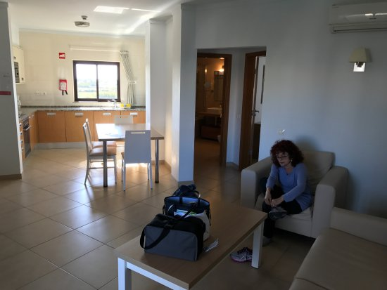 Sagres Time Apartamentos : View of living, dining and kitchen areas with bath and bedroom in background