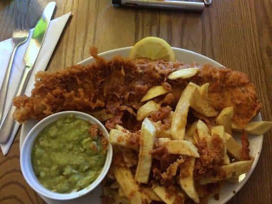 Brighouse, UK: special haddock, scraps, mushy peas