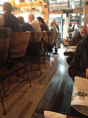 Black Diamond Restaurant And Tap House Beautiful Wood Flooring With Barrel Bar Seating