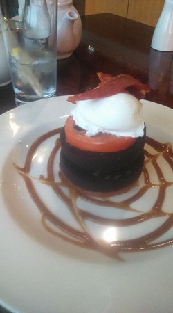 Sale, UK: Black pudding Stack, with poached egg, bacon & tomato.