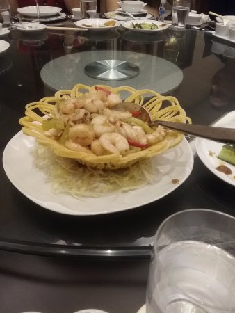 Spicy seafood dish on a noodle basket
