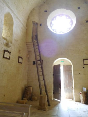Biron, France: Unusual feature inside the village church