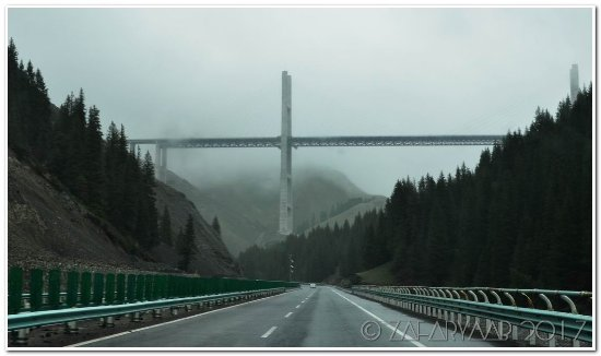Huocheng County, China: The bridge appears as you reach near the top of valley
