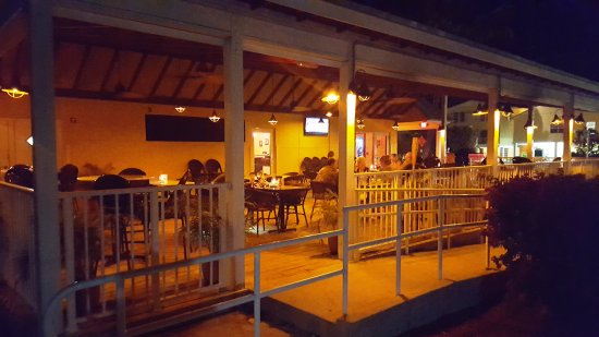 Lime Tree Bay Resort Restaurant Adjacent To The With Indoor And Outdoor Dining