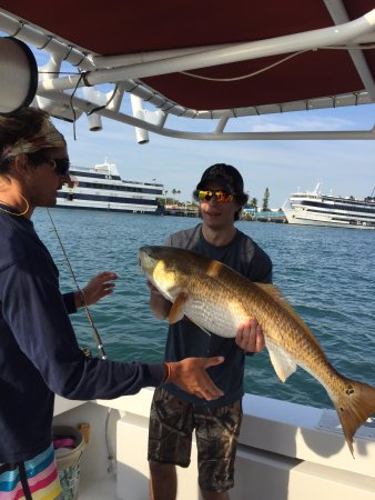 Arts Adventures - Private Charters: Big Redfish caught on way out of port