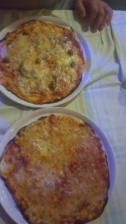 Baobab Pizzeria: our 2 pizza which were finished in few seconds, very delicious