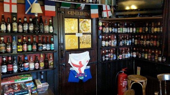 Gillingham, UK: Real pub atmosphere and great decor of beer bottles, key rings, wood burner...