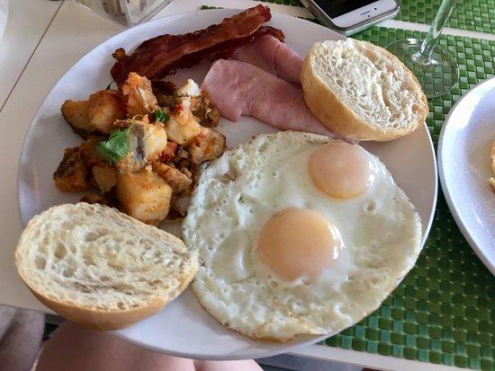 Palmer, Portorico: eggs over easy, ham, toast, potatoes, bacon, yum!