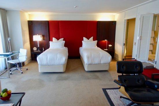 The Spire Hotel Queenstown: The Spire Hotel, room, beds, desk.