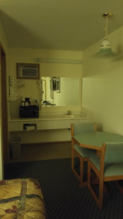 The Ranchland Inn: Table, sink, microwave, coffee maker, door behind photographer