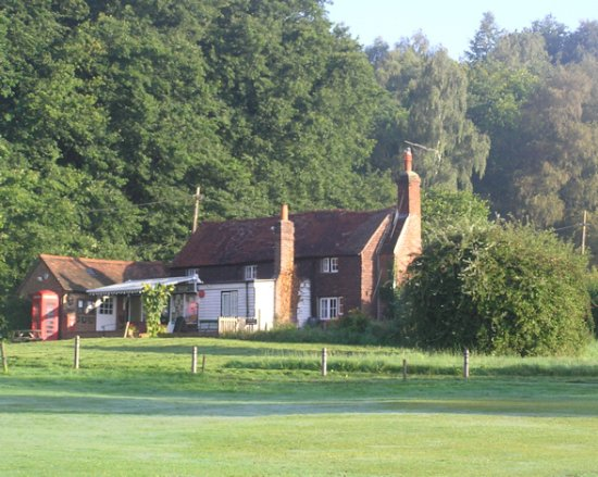 Hambledon, UK: The Shop is housed in a 16th century building next to the cricket green.
