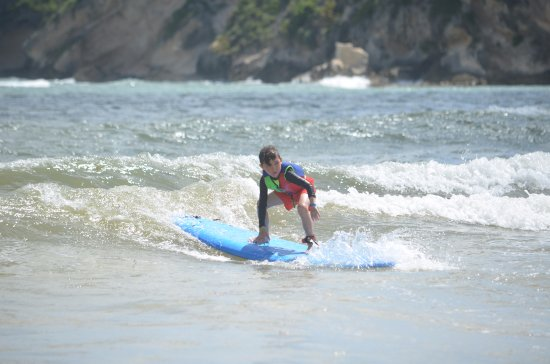 Coast Riders Surf Shop & Surf Lessons: One of many waves that my son caught thanks to the team!
