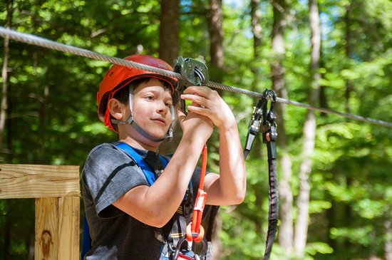 Candia, NH : Unclipping from the zip line from pod 1