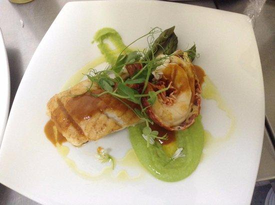 St Agnes, UK: Local Turbot fillet & lobster with pea puree, asparagus, lobster bisque sauce & lemon oil.