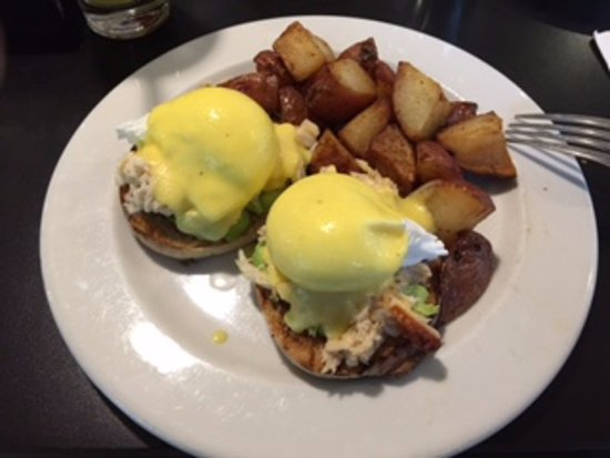 dungeness crab eggs benedict with herb roasted potatoes