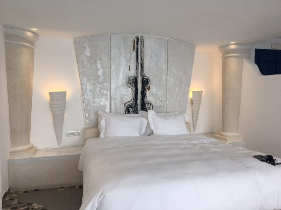 Huge and very comfortable bed picture of astarte suites for Astarte suites prices