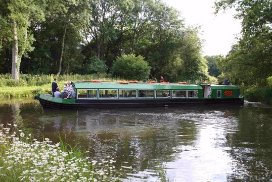 Loxwood, UK: The Wey and Arun Canal Trust's electric trip boat Wiggonholt.
