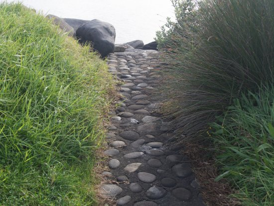New Plymouth, New Zealand: A short path leading from parking to jetty boulders