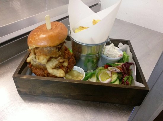 Borth-y-Gest, UK: BBQ pulled pork burger served with skin on fries, homemade onion rings, salad and apple sauce