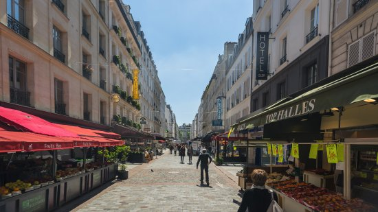 View of rue cler with cler hotel on the right picture for Cler hotel paris