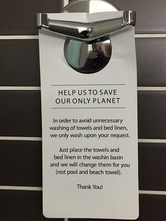 "Hotel Coral Suites & Spa: A sign in the bathroom ""Just place towels &"
