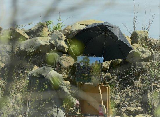 Artist painting a beautiful scene along the Chippewa River Trail
