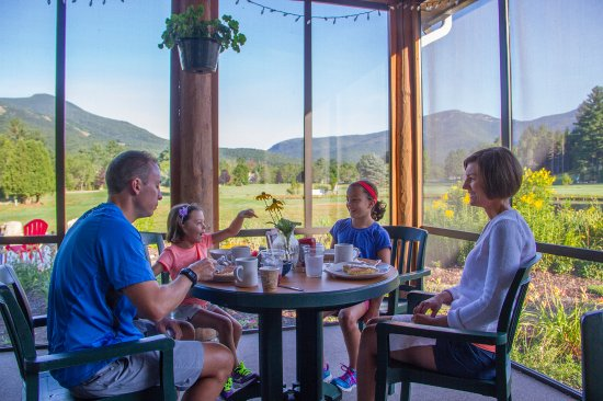 Waterville Valley, NH: Dine inside our 4-season porch for casual food and spectacular views