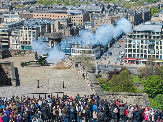 The one o' clock gun being fired from Edinburgh Castle