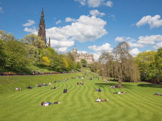 Edinburgh, UK: People enjoying the sun in Princes Street Gardens