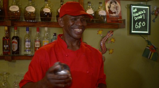 Marigot, Dominica: Our well known cheif mixing a drink