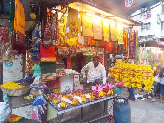 Mahalakshmi Temple: An Indian man selling flowers near Mahalakshmi Mandir