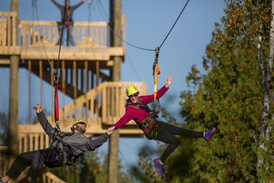 Baileys Harbor, WI: People zip lining on the course in Door County, WI