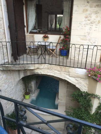 Bourg-Saint-Andeol, France: View of the inner courtyard and pool