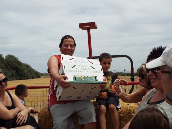 Queen Creek, AZ: My son Tony Jr. and grandson John with their peaches and enjoying the hayride.