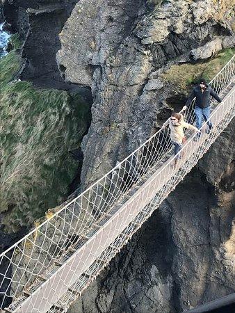 Ballintoy, UK: My friends crossing the bridge after me