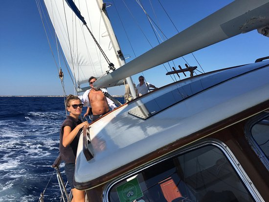 Vita Bel II: A really good sailing day in Cala d'Or with Agnes our 1st mate, holding on tight.