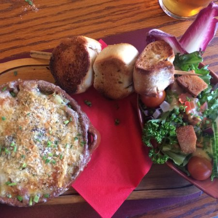 Austwick, UK: Raclette with garlic bread skewer and salad